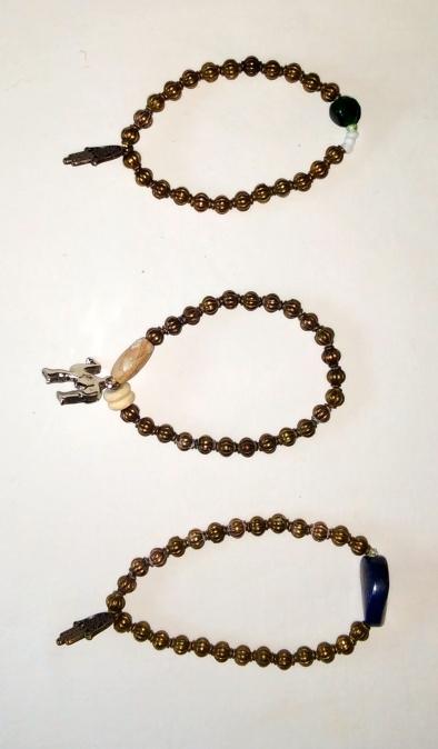 Perles cuivrées et breloques